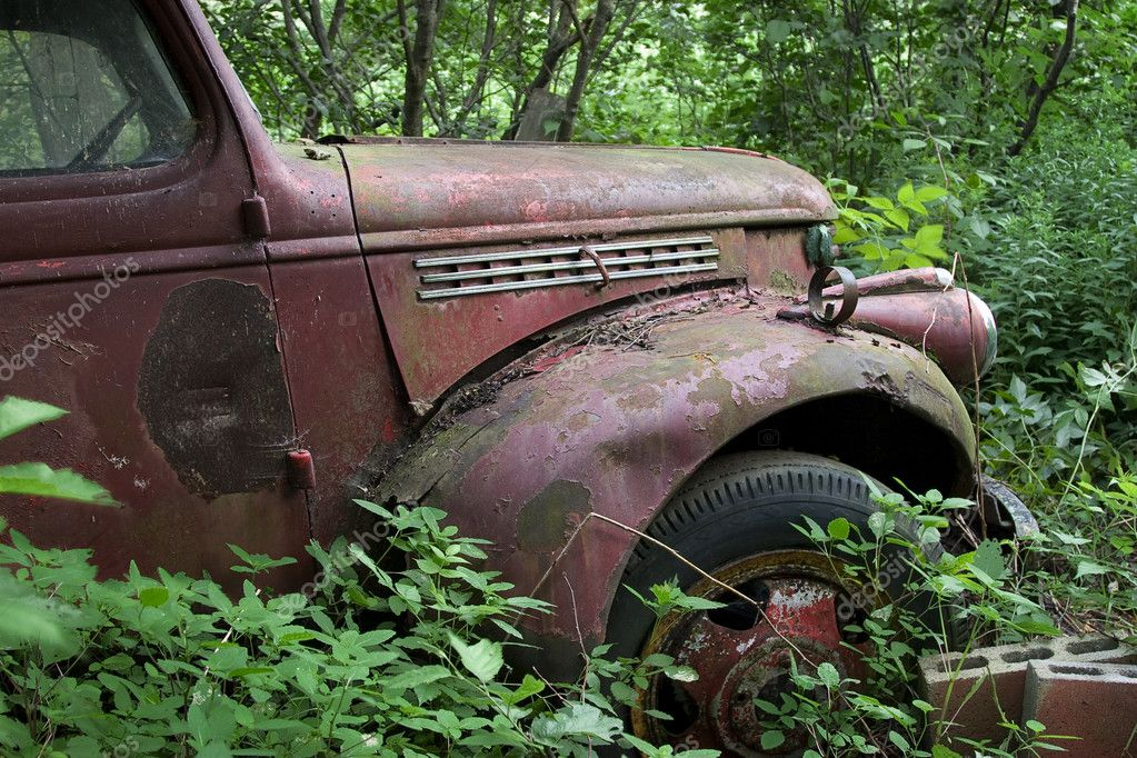 Old rusted truck stuck in the