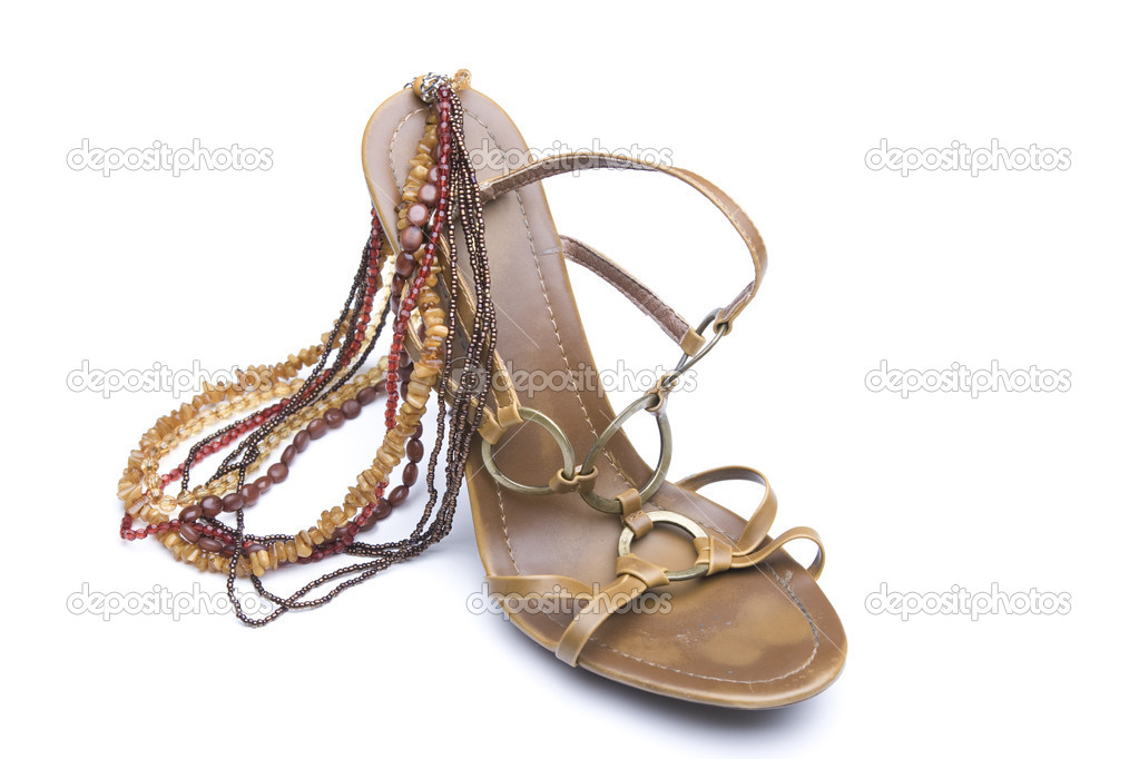 Brown high heels with necklace — Stock Photo #4318747