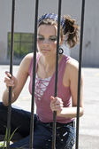 Girl behind fence — Stock Photo