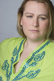 Overweight woman looking sad — Stock Photo