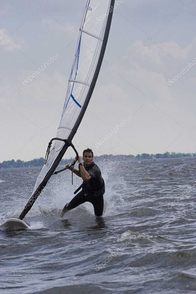 Male windsurfer doing the body drag trick — Stock Photo #4352146
