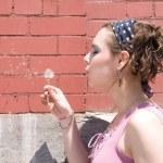 Girl blowing dandelion — Stock Photo #4362021