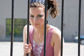 Fashion model in jail — Stock Photo