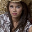 Cowgirl in barn — Stock Photo