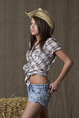 Cowgirl and her gun — Stock Photo