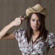 Stock Photo: Depressive cowgirl