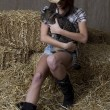 Cowgirl and her cat — Stock Photo