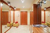 Elegance anteroom interior in warm tones with hallstand