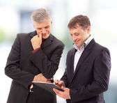 Two businessmen discussing - Isolated studio picture in high resolution.