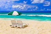Chairs and umbrella at tropical beach