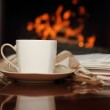 Постер, плакат: Tea by the fireplace