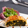 thumbnail of Slice of a spinach strudel on a plate