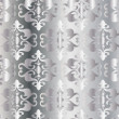 Abstract silver floral pattern.