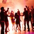 thumbnail of Young students dancing with joy in a disco