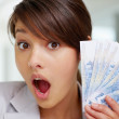 thumbnail of Surprised - Young woman with fan of currency notes