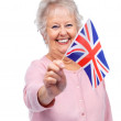 thumbnail of Senior female holding a flag of United Kingdom