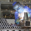 thumbnail of Labourer arc welding