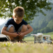 thumbnail of Little boy playing at camping site
