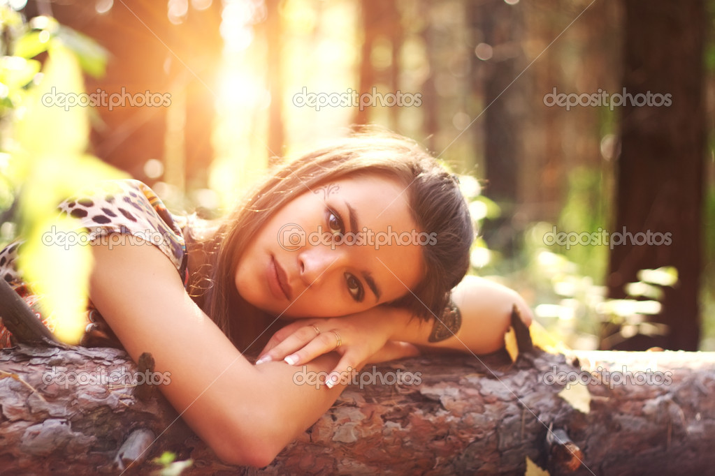 Attractive girl on a background of trees