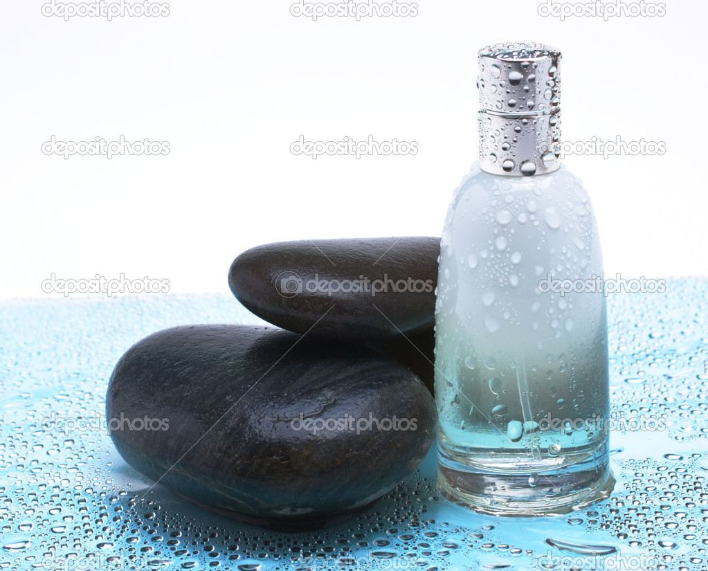 Bottle of cologne wet and pebbles