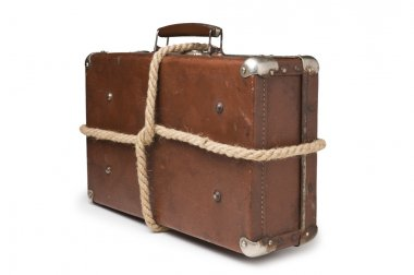 Old suitcases tied with rope