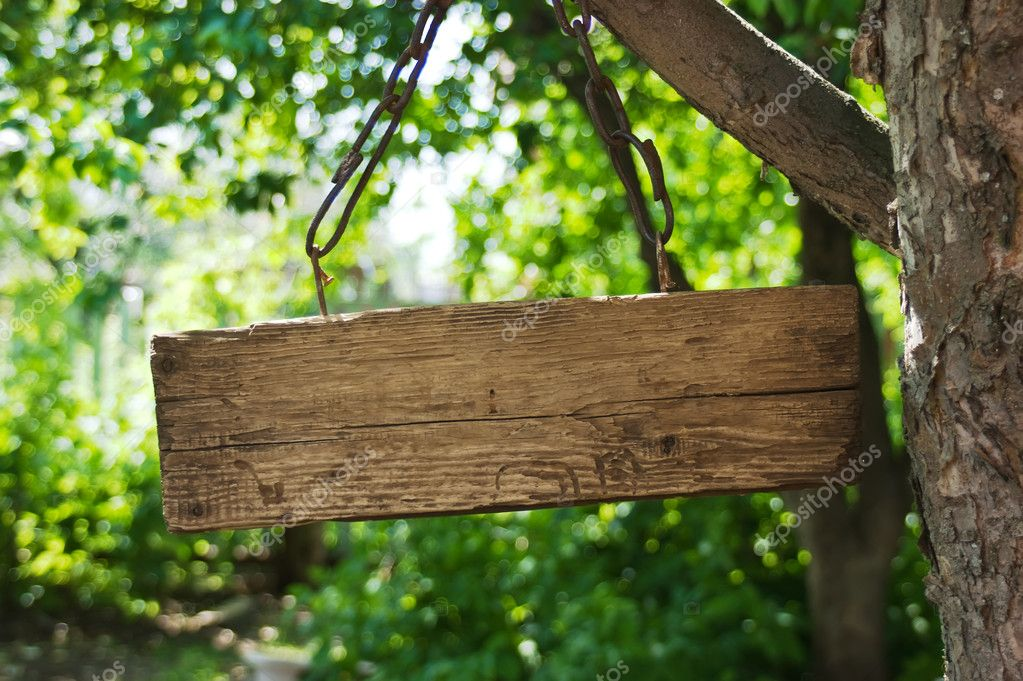 Old wooden sign on the chain