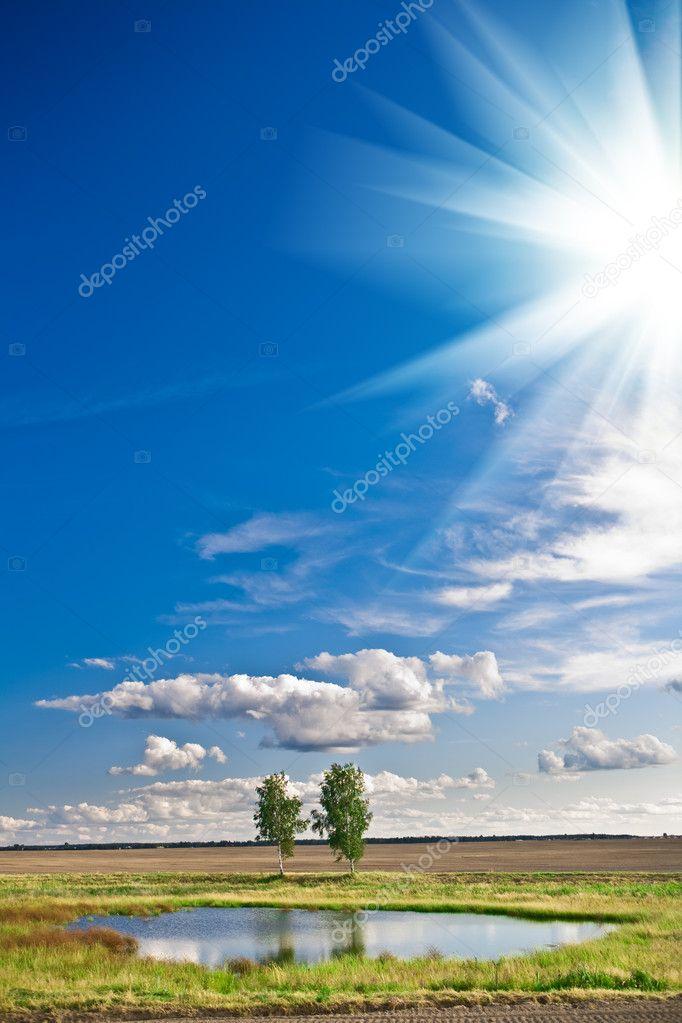 Lake and sky with sun
