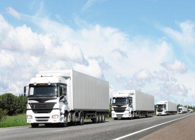 Caravan of white trucks on country highway under blue sky stock vector