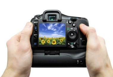 Black digital camera in hands stock vector