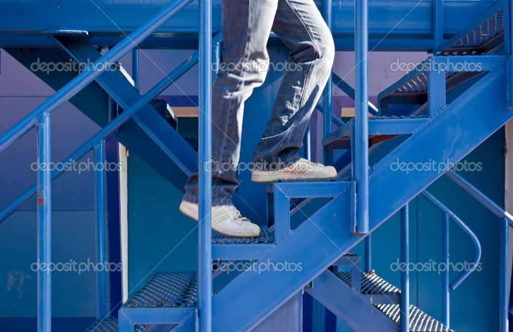 A man running up the stairs