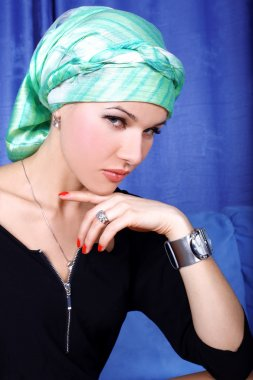 Woman in green east arabic turban