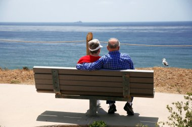 Elderly couple at sea with seagull