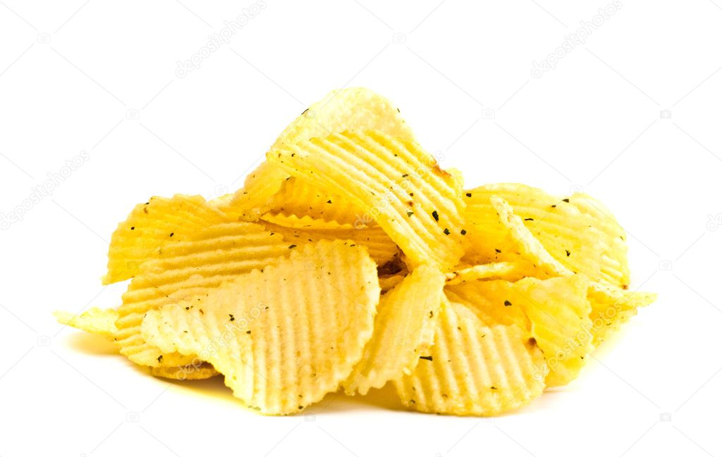 Handful of yellow potato chips