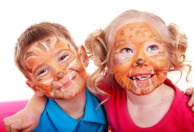 Children with paint of face.
