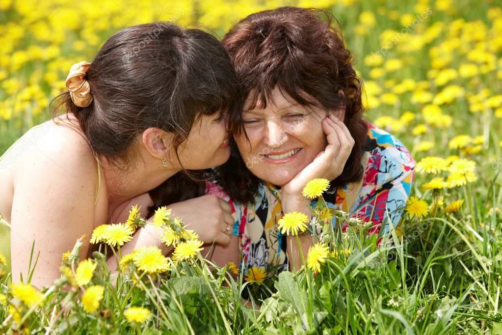 Grandmother with daughter in outdoor.