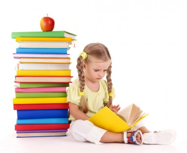 Child sitting on pile of books.
