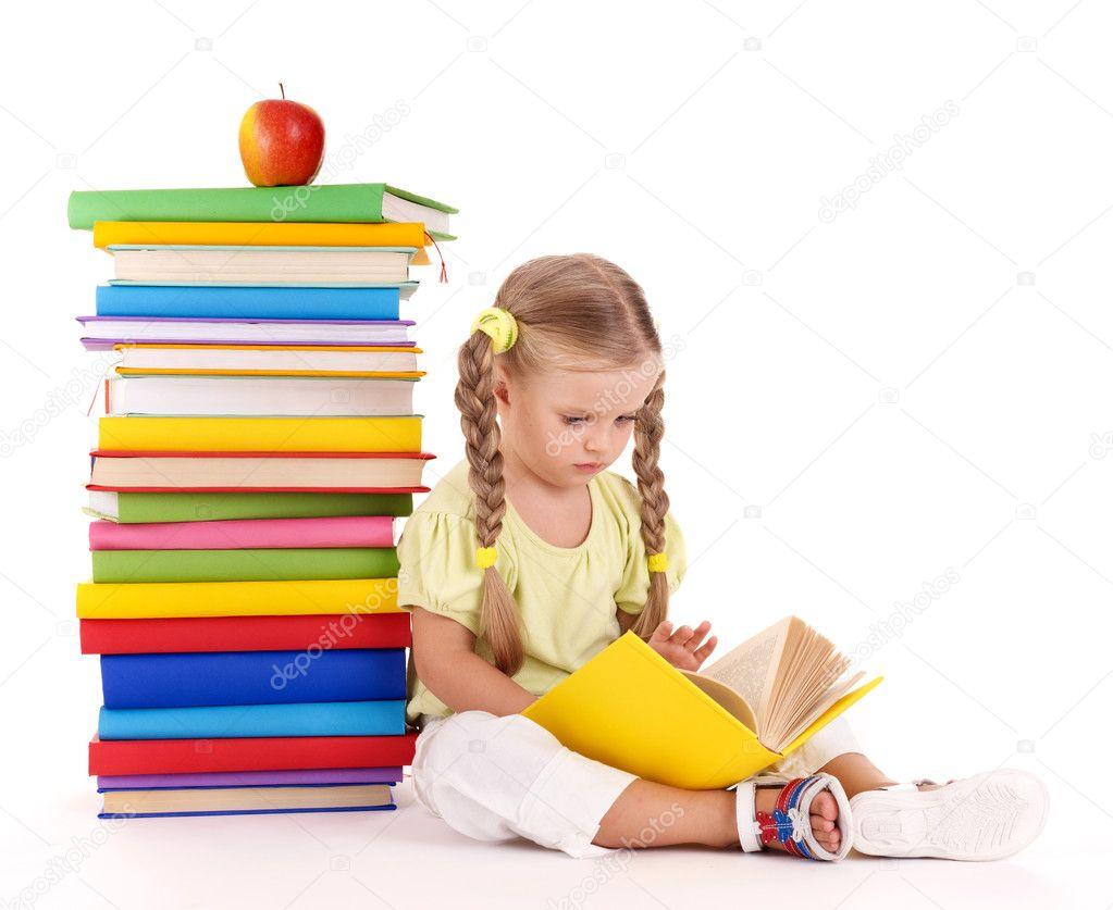 Child sitting on pile of books.