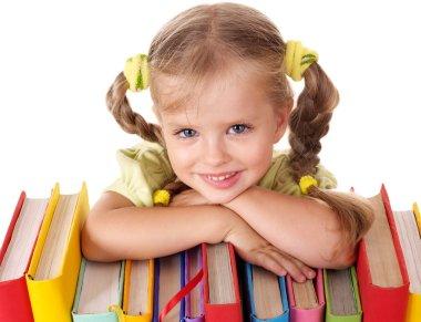 Child holding pile of books.