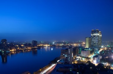 Panorama across Cairo skyline at night