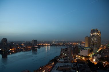 Panorama across Cairo skyline as dusk