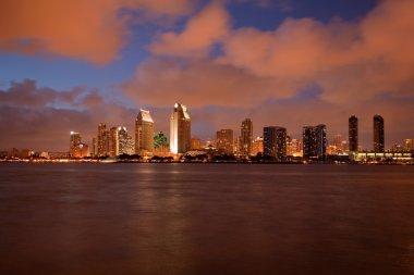Orange clouds reflect light from San Diego Skyline