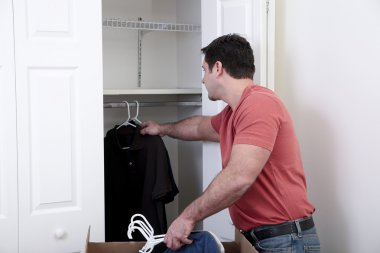 Putting the clothes away