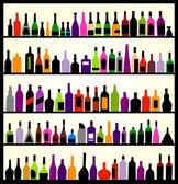 Fotografia bottiglie di alcolici sul muro