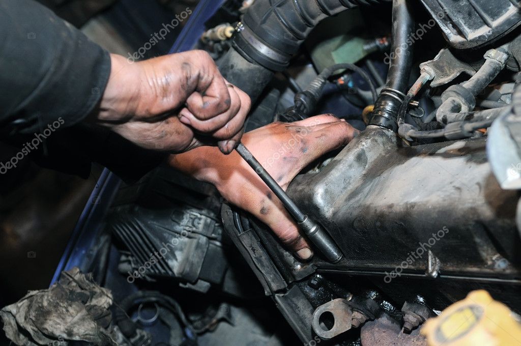 Car Mechanic Hard At Work