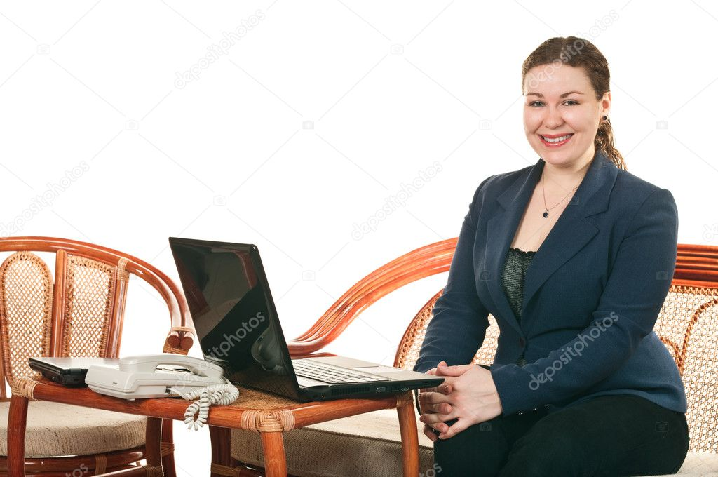 Womanl with the laptop sits at a table