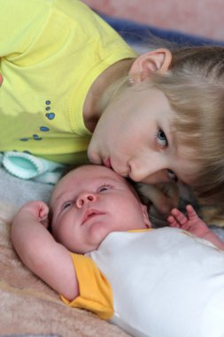 Girl with her little brother
