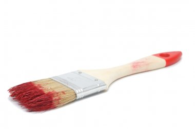 Painting brush with a red paint isolated