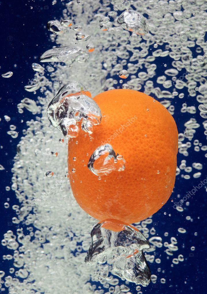 Orange (mandarin) falling in water