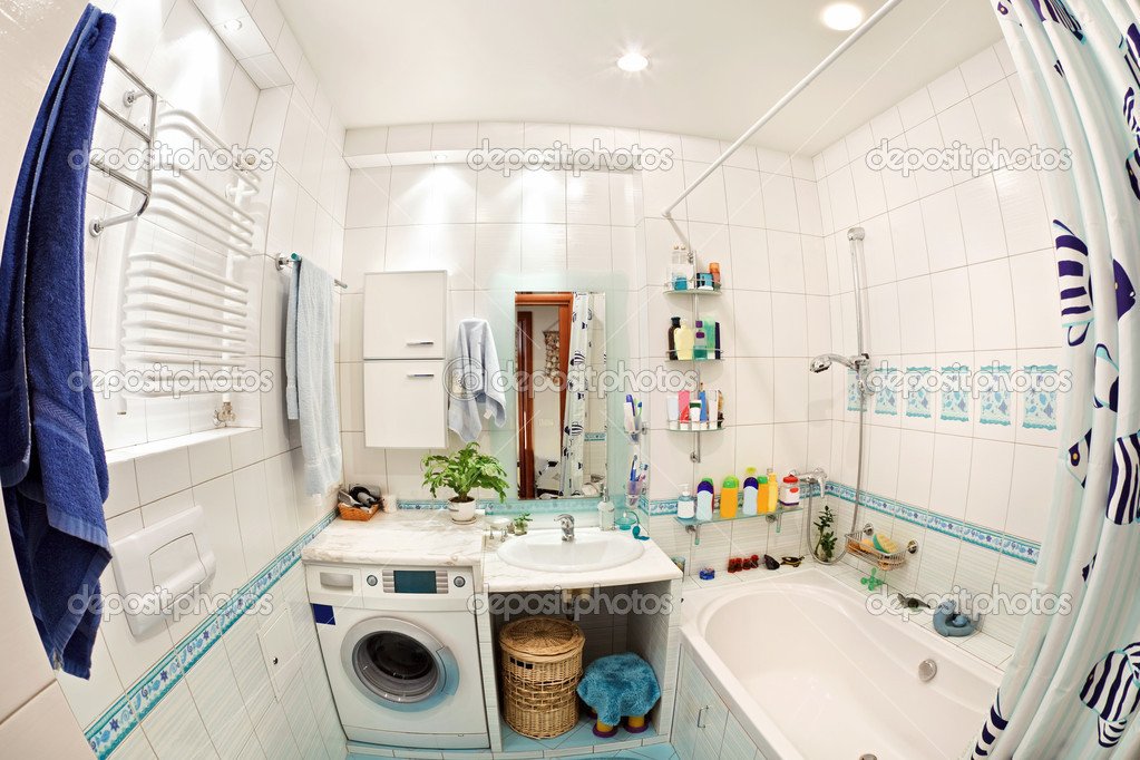 Modern small bathroom in blue colors wide angle view