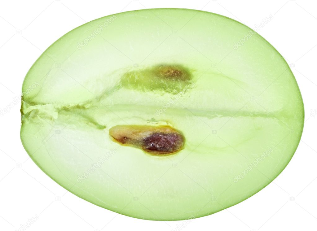 Translucent slice of green grape fruit, macro isolated on white